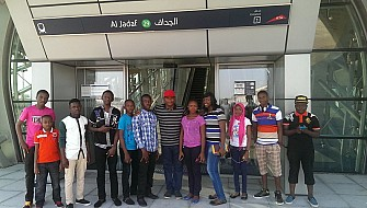 Students at Al-jadaf train station